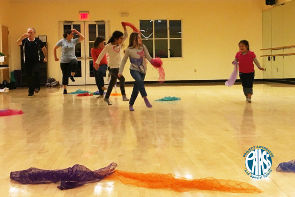 Project Awareness and Special Sports skipping together in dance class